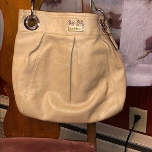 Tan leather coach hobo bag.  Clean, smooth, yes.